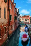 Narow canal with boats in Venice, Italy. Royalty Free Stock Photography