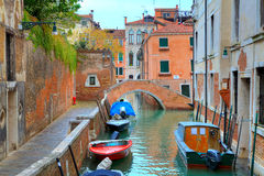Boats on canal among houses. Venice, Italy. Royalty Free Stock Images