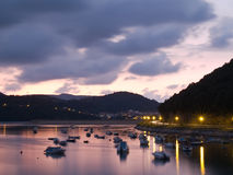 Boats at the natural district of Urdaibai at dusk Royalty Free Stock Photos