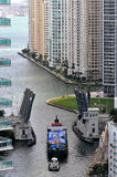 Boats navigating the Miami River Stock Images