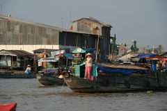 Boats are navigating on a river (Vietnam). Stock Photos