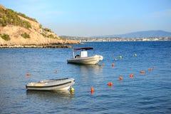 Boats near beach at modern luxury hotel Royalty Free Stock Photos