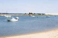 Boats near the coast in front of Pilat dune Royalty Free Stock Photos