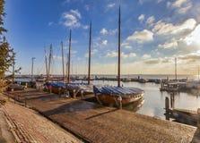 Boats Near Dock Under Gray Sky Stock Image