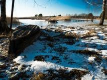 Boats near frozen lake. Winter landscape Stock Photography