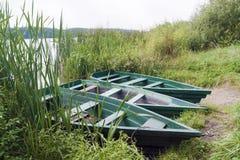 Boats near the grassy shore Stock Photography