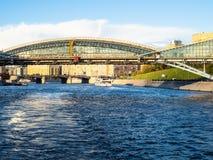 Boats near Kievsky Bridge in Moscow city stock images