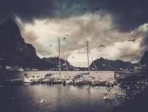 Boats near moorage in Reine village, Norway Royalty Free Stock Photography