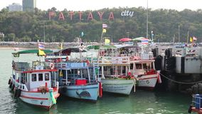 Boats near Pattaya bay, Gulf of Siam, Thailand. THAILAND, PATTAYA, APRIL 12 2014: Boats near Pattaya bay, Gulf of Siam, Thailand stock footage