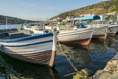 Boats near the pier in the picturesque bay. Fishing boats on the dock in Balaclava Bay royalty free stock image