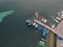 The boats near the pier. Porto Cesario, Puglia, Italy. Drone aerial photo royalty free stock images
