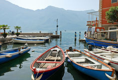 Boats near pier in town limone sul garda Royalty Free Stock Photos