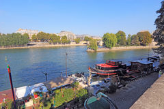 Boats near Pont Neuf and Ile de la Cite in Paris, France Royalty Free Stock Images