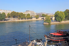 Boats near Pont Neuf and Ile de la Cite in Paris, France Stock Photography