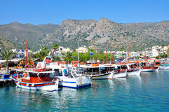 Boats near the shore. Fishing boats at the pier, Crete, Greece Stock Image