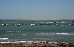 Boats near the shore of the ancient sea town of Cadiz. Royalty Free Stock Photo