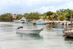 The boats near the shore in Bayahibe, La Altagracia, Dominican Republic. Copy space for text. The boats near the shore in Bayahibe, La Altagracia, Dominican stock photography