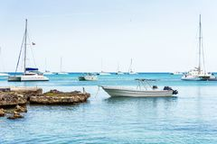 The boats near the shore in Bayahibe, La Altagracia, Dominican Republic. Copy space for text. The boats near the shore in Bayahibe, La Altagracia, Dominican stock images