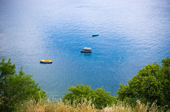 Boats near the shore Stock Images