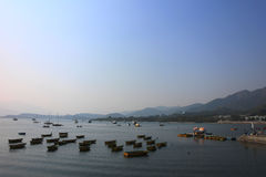 Boats near a village Stock Images
