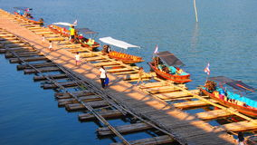 Boats next to the bamboo bridge crossing the river Stock Image