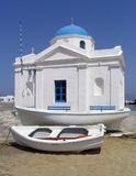 Boats next to seaside church, Mykonos, Greece. Boats next to seaside church, in Mykonos, Greece Stock Images
