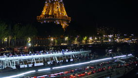 Boats next to shining Eiffel Tower at night in Paris. The Eiffel tower building is a wrought iron lattice tower on the Champ de Mars in Paris, France stock video