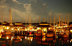 Boats at night. Night at a Naples Bay marina, Florida Royalty Free Stock Photography