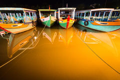 Boats at night in Hoi An, Vietnam, Asia. Royalty Free Stock Images
