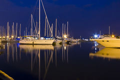 Boats in night. Illuminated boats at night with reflection Stock Images