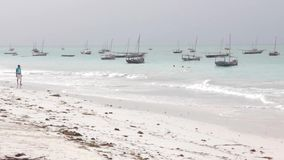 Boats on Nungwi white-sand beach, Zanzibar. Tanzania stock video
