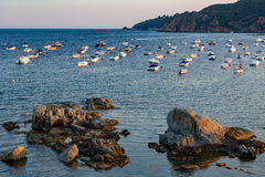Boats in the ocean en Tamariu (small village in Costa Brava, Cat Royalty Free Stock Images