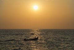 Boats in ocean at sunset Stock Image