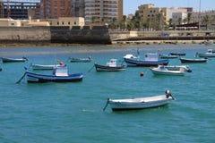 Boats off the coast of Cadiz near the fortress of Castillo Fortaleza de Santa Catalina. Royalty Free Stock Images