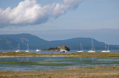 Boats off-shore of Spencer spit state park. Lopez Island Stock Image