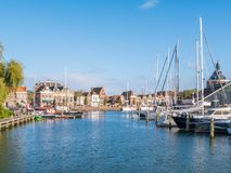 Boats in old harbor of city of Enkhuizen, North Holland, Netherl royalty free stock image