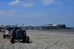 Boats, Old Tractor & Cromer Pier, Norfolk, UK Stock Image