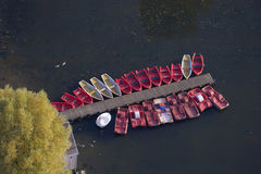 Boats in Olympic park lake. An aerial view of boats moored beside the jetty on the lake in the Olympic Park at Munich, Germany Royalty Free Stock Photos