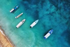Free Boats On The Water Surface From Top View. Turquoise Water Background From Top View. Summer Seascape From Air. Gili Meno Island, In Royalty Free Stock Images - 148337399