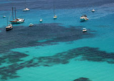 Boats over clear waters in Lampedusa Royalty Free Stock Photo