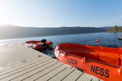 Boats over the lake of Loch Ness, Scotland. Two red boats over the Loch Ness lake, near Inverness. Scotland, UK Stock Images