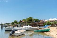 Cap Ferret, Arcachon Bay, France. Boats and oyster restaurant on the beach of Cap Ferret, on the Arcachon Bay, France Stock Photos