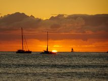 Boats on the pacific ocean waters of Waikiki at Sunset Royalty Free Stock Photography
