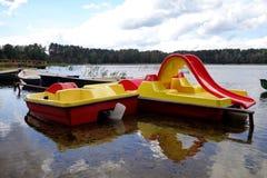 Boats and paddle boats Royalty Free Stock Photos