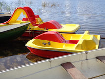 Boats and paddle boats Stock Photos
