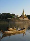 Boats and pagoda Stock Photos
