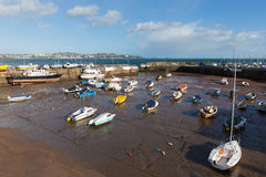 Boats in Paignton harbour Devon England with view to Torquay. Paignton harbour Devon England UK at low tide with view towards tourist destinations of Torquay royalty free stock image