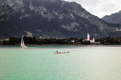 Boats and panoramic views of Forggensee lake, Germany Stock Photography