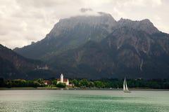 Boats and panoramic views of Forggensee lake, Germany Royalty Free Stock Photo