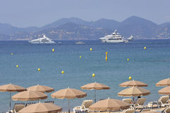 Boats and parasols at Cannes in France Stock Photos